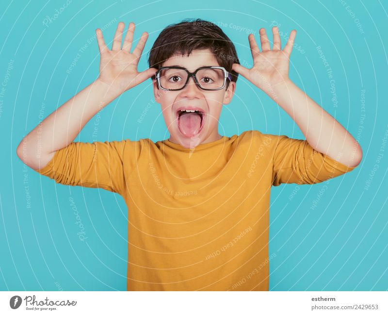 funny boy with glasses show out his tongue Lifestyle Joy Human being Masculine Child Toddler Boy (child) Infancy 1 8 - 13 years Eyeglasses Fitness Smiling