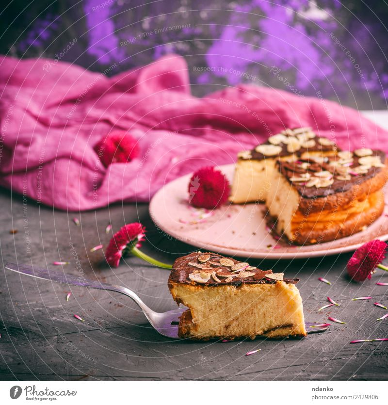 pieces of cheesecake with chocolate Cheese Dairy Products Dessert Lunch Plate Restaurant Flower Eating Fresh Delicious Pink Black Almond background Baking