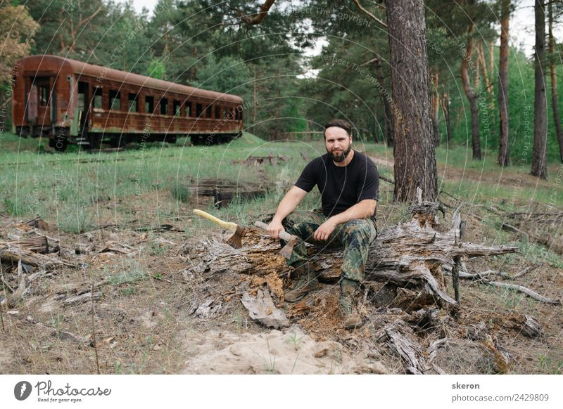 bearded woodsman with an axe sitting next to rusty train Human being Nature Youth (Young adults) Beautiful Green Young man Landscape Hand Tree 18 - 30 years