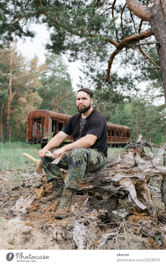 bearded huntsman sitting on the root of a dry tree Human being Sky Nature Vacation & Travel Youth (Young adults) Man Plant Landscape Tree 18 - 30 years Adults
