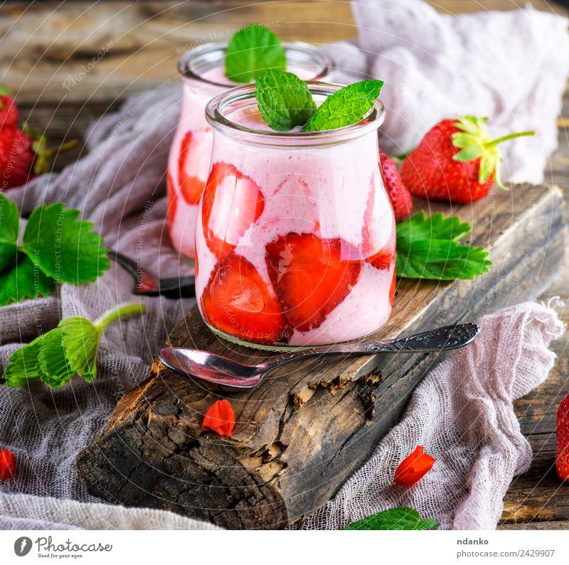 smoothies of fresh strawberries Yoghurt Dairy Products Fruit Dessert Breakfast Diet Beverage Cold drink Spoon Table Wood Eating Dark Fresh Juicy Green Red