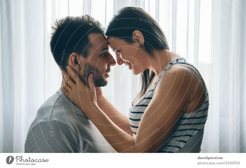 Embracing couple looking into eyes Lifestyle Happy Beautiful Human being Woman Adults Man Family & Relations Couple Beard Smiling Love Embrace Happiness