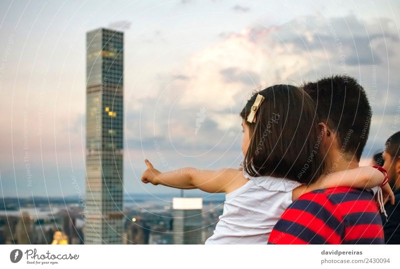Man holding little girl pointing skyscraper of Manhattan skyline Vacation & Travel Tourism Sightseeing Woman Adults Fingers Earth Sky Downtown Skyline High-rise