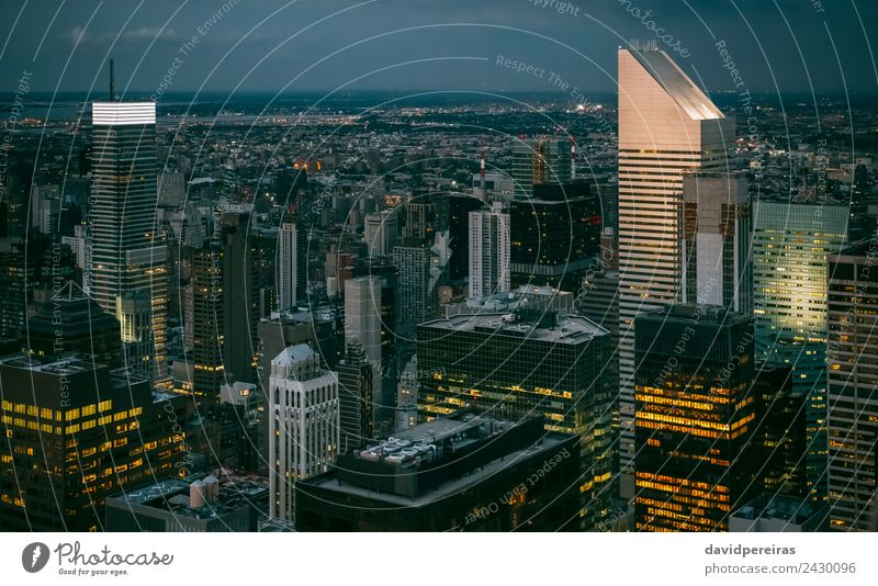 Skyline of Manhattan at night with skyscrapers lights Design Wallpaper Workplace Office Business Downtown High-rise Building Architecture Facade Aircraft Steel