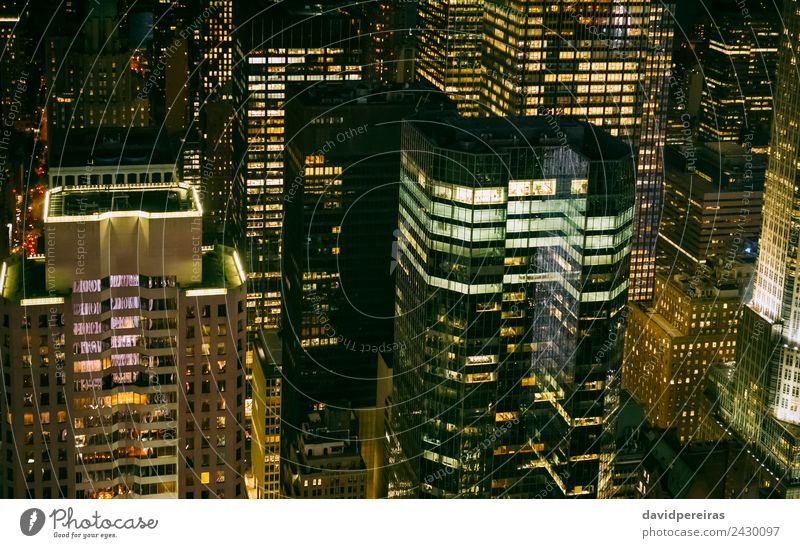 Skyscrapers windows illuminated at night in Manhattan Design Wallpaper Workplace Office Business Downtown Skyline High-rise Building Architecture Facade