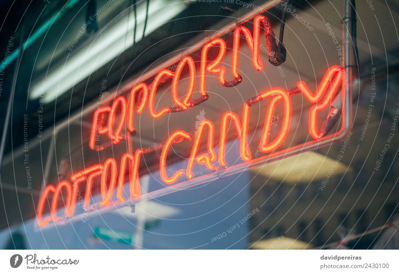 Red neon sign with words Popcorn Cotton Candy Shopping Design Decoration Entertainment Signage Warning sign Glittering Write Dark Bright Retro Colour
