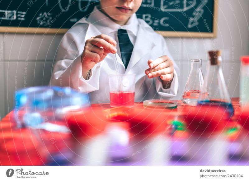 Kid playing to be chemist with colorful liquids Bottle Spoon Playing Flat (apartment) Table Science & Research Child Classroom Laboratory Human being