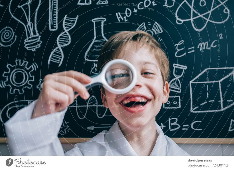 Happy kid looking at camera through magnifying glass Joy Playing Flat (apartment) Science & Research Child School Classroom Blackboard Laboratory Human being