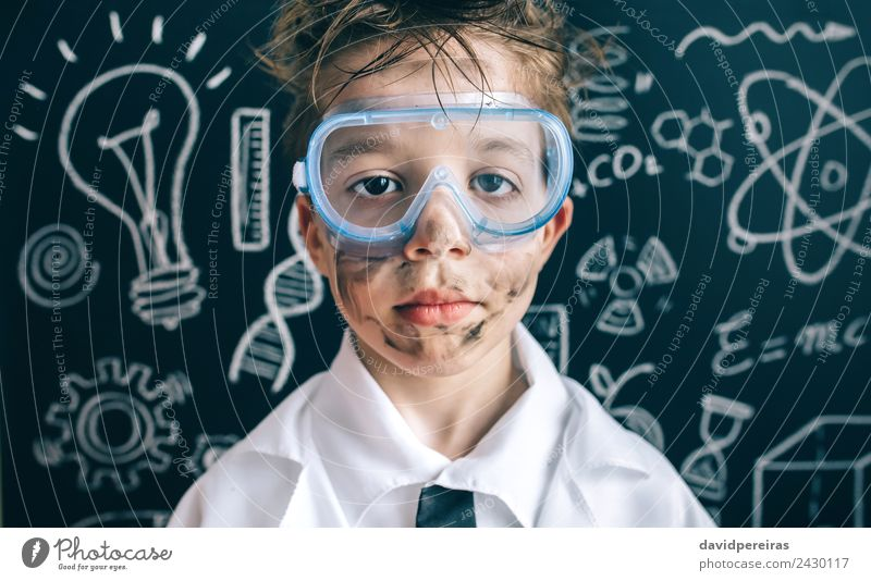 Little chemist in glasses looking seriously at camera Face Flat (apartment) Science & Research Child School Classroom Blackboard Laboratory Human being