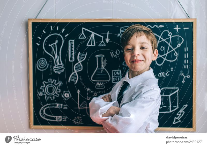 Smiling kid looking at camera in front of blackboard Happy Playing Flat (apartment) Science & Research Child Classroom Blackboard Laboratory Human being