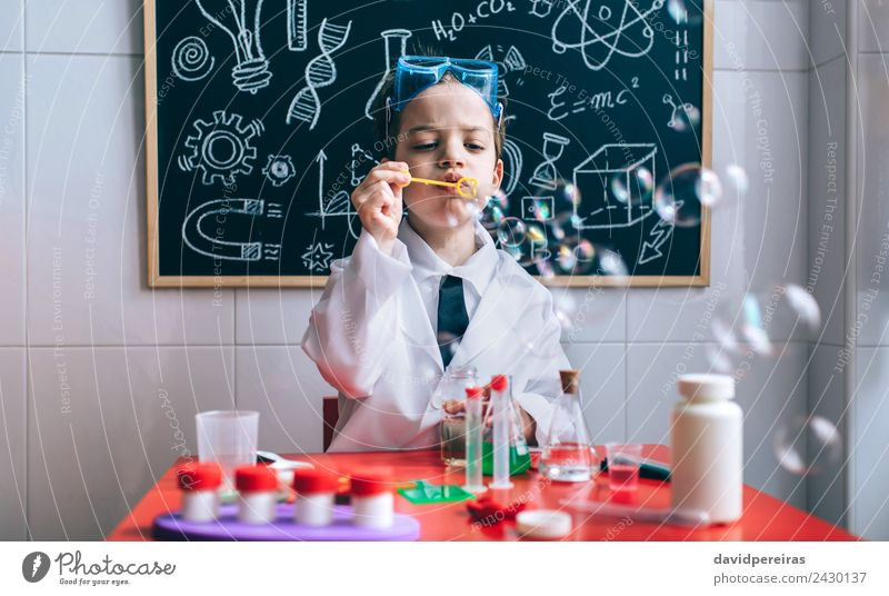 Kid doing soap bubbles against of drawn blackboard Bottle Joy Happy Playing Flat (apartment) Table Science & Research Child School Classroom Blackboard