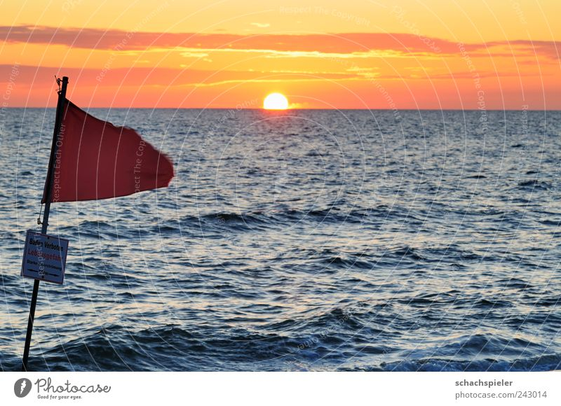 Huch - a sunset Relaxation Vacation & Travel Tourism Summer Summer vacation Sun Beach Ocean Waves Nature Water Clouds Sunrise Sunset Coast North Sea Flag Blue