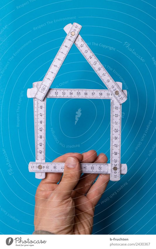 House construction - folding rule - planning Craftsperson Craft (trade) Construction site Tool Tape measure Man Adults Hand Fingers Build Utilize To hold on