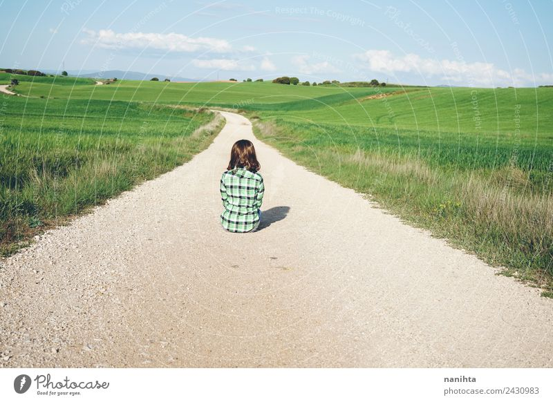 Young woman sitting alone in a rural path Lifestyle Style Design Harmonious Relaxation Adventure Far-off places Freedom Human being Feminine