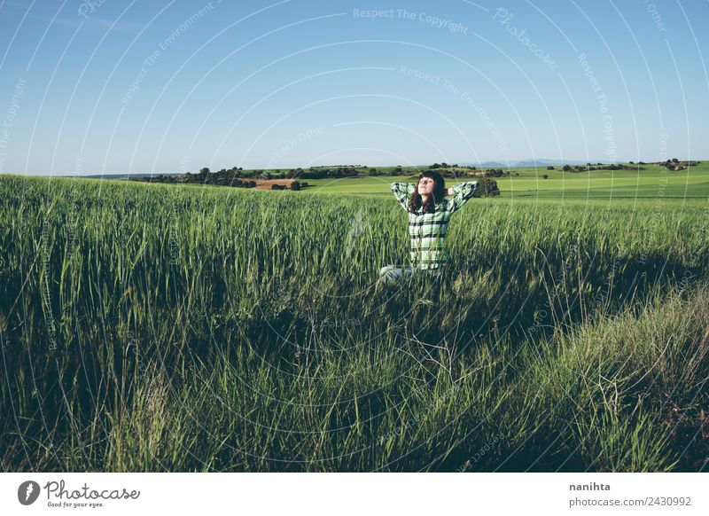 Young woman enjoying the day in a green field Human being Nature Vacation & Travel Youth (Young adults) Summer Beautiful Green Landscape Relaxation Joy