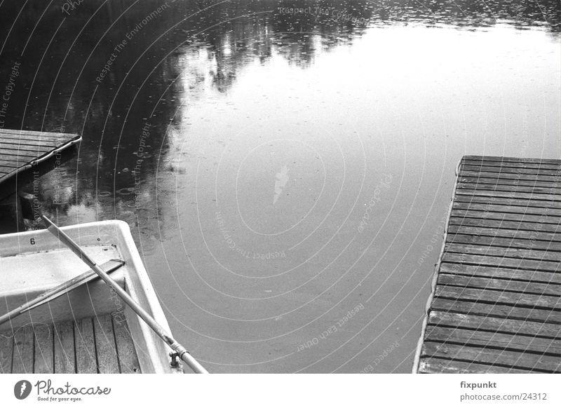 1632-025 Lake Rain Footbridge Watercraft Dreary Black & white photo