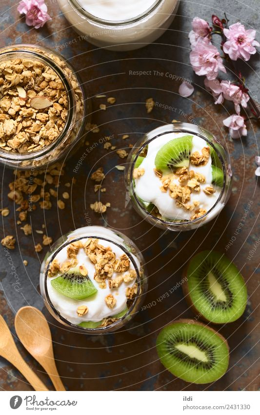 Yogurt Granola and Kiwi Parfait Yoghurt Fruit Dessert Fresh food parfait kiwi Cereal Crunchy oatmeal Almond Dairy healthy Snack sweet Meal layered glass jar