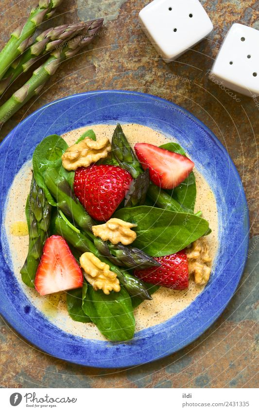 Strawberry Asparagus Spinach and Walnut Salad Vegetable Fruit Fresh food Raw walnut oil healthy Vegan diet Home-made Meal appetizer Snack served overhead