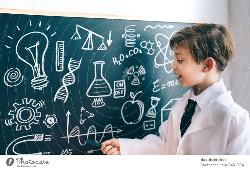 Side view of boy showing drawing on chalkboard Happy Playing Flat (apartment) Science & Research Child Classroom Blackboard Laboratory To talk Human being