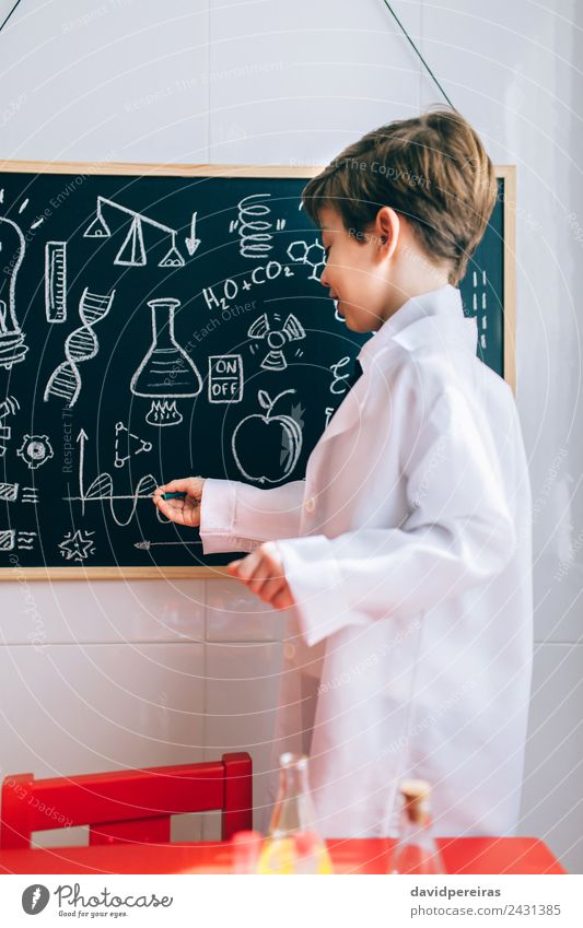 Kid showing drawings on chalkboard with marker Happy Playing Flat (apartment) Science & Research Child Classroom Blackboard Laboratory To talk Human being