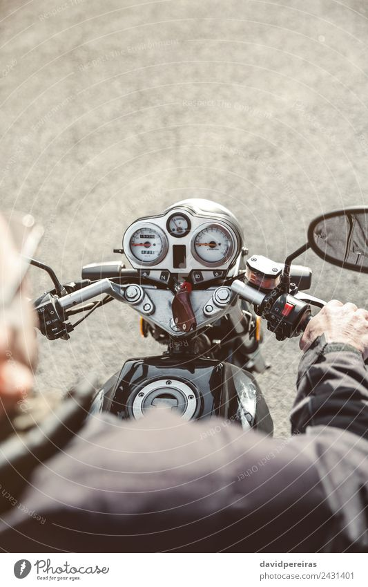 Senior man steering motorcycle on road Human being Vacation & Travel Man Old Hand Black Street Adults Trip Transport Metal Retro Authentic Adventure Speed