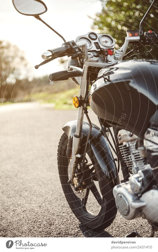 Black motorcycle on road over nature background Vacation & Travel Trip Adventure Cruise Nature Tree Transport Street Vehicle Motorcycle Metal Steel Glittering