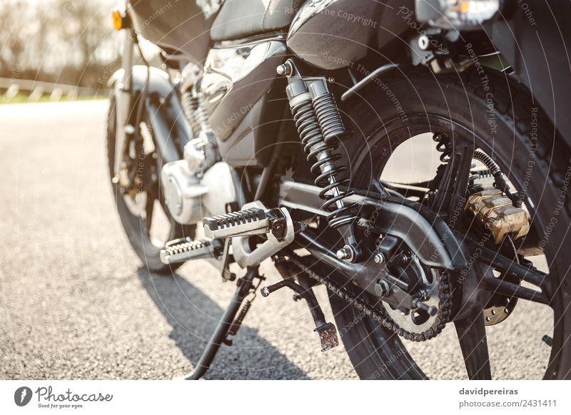Shock absorber and chain of black motorcycle Nature Vacation & Travel Green Black Street Trip Transport Metal Retro Glittering Adventure Speed New Asphalt Steel