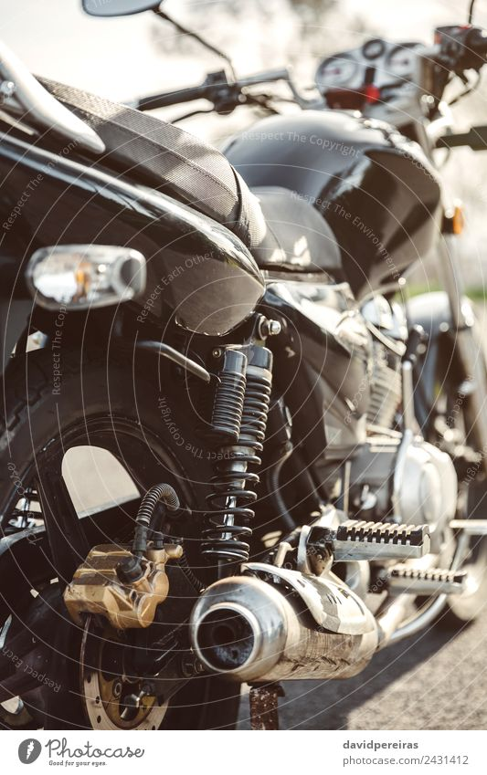 Shock absorber and exhaust pipe of black motorcycle Vacation & Travel Trip Adventure Nature Transport Street Vehicle Motorcycle Metal Steel Glittering New Retro