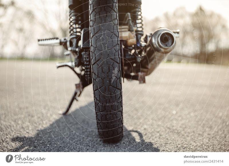 Wheel and exhaust pipe of motorcycle on road Nature Vacation & Travel Green Black Street Trip Transport Metal Retro Glittering Adventure Speed New Asphalt Steel