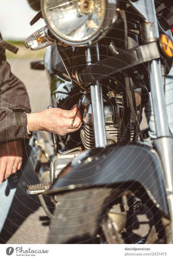 Senior man repairing damaged motorcycle engine Human being Vacation & Travel Man Old Hand Black Street Adults Lifestyle Trip Transport Metal Retro Authentic