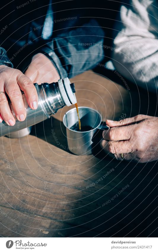 Senior couple hands pouring coffee from thermos Woman Human being Man Old Hand Relaxation Adults Lifestyle Love Wood Couple Together Leisure and hobbies Metal