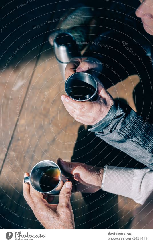 Senior couple hands holding cups with coffee Woman Human being Man Old Hand Relaxation Adults Lifestyle Love Wood Couple Together Leisure and hobbies Metal Sit