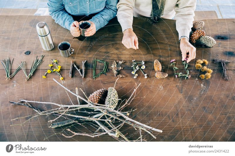Senior couple with wanderlust word wrote over table Coffee Lifestyle Vacation & Travel Trip Adventure Table Craft (trade) Woman Adults Man Couple Hand Nature