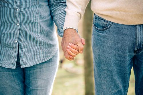 Senior couple holding hands over nature background Lifestyle Relaxation Leisure and hobbies Retirement Human being Family & Relations Couple Adults Hand Nature