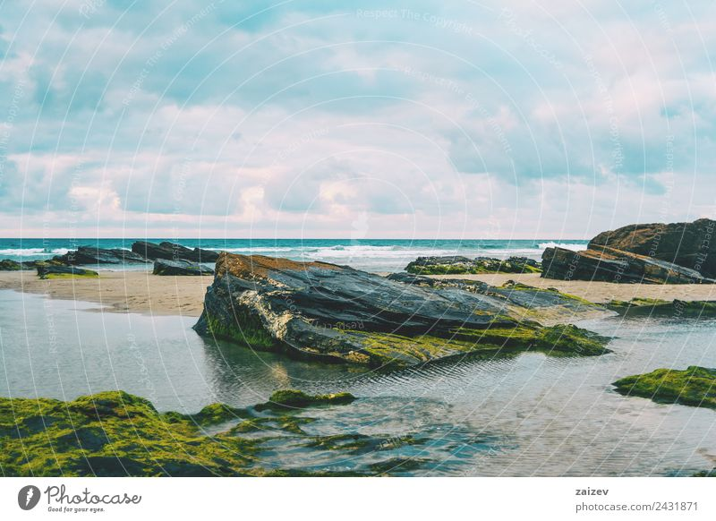 Beach with rocks and puddle in a sunset, ribadeo, lugo, galician, spain Exotic Vacation & Travel Tourism Ocean Island Waves Nature Landscape Sand Horizon