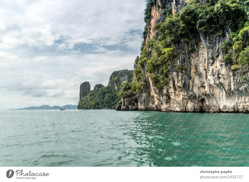 Rock in Phang Nga Bay Vacation & Travel Trip Adventure Far-off places Summer Summer vacation Ocean Island Waves Nature Landscape Sky Clouds Coast Andaman Sea