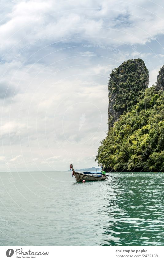 Longtail boat in front of rocks in Thailand Calm Vacation & Travel Tourism Trip Adventure Far-off places Summer Summer vacation Ocean Island Waves Environment