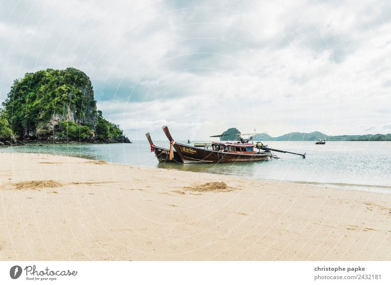 Longtail boats lie on the beach of an island in Thailand Vacation & Travel Far-off places Summer Summer vacation Beach Ocean Island Landscape Clouds Warmth