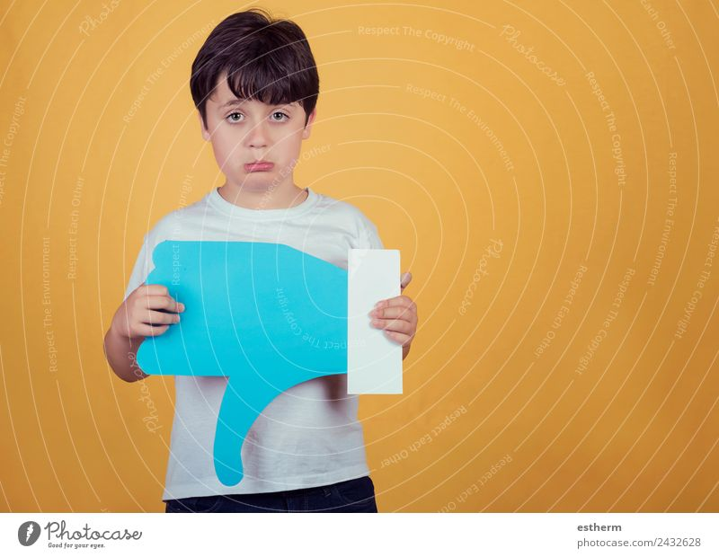 sad boy with a big dislike on yellow background Lifestyle Human being Masculine Child Toddler Boy (child) Infancy 1 8 - 13 years Sign Signs and labeling