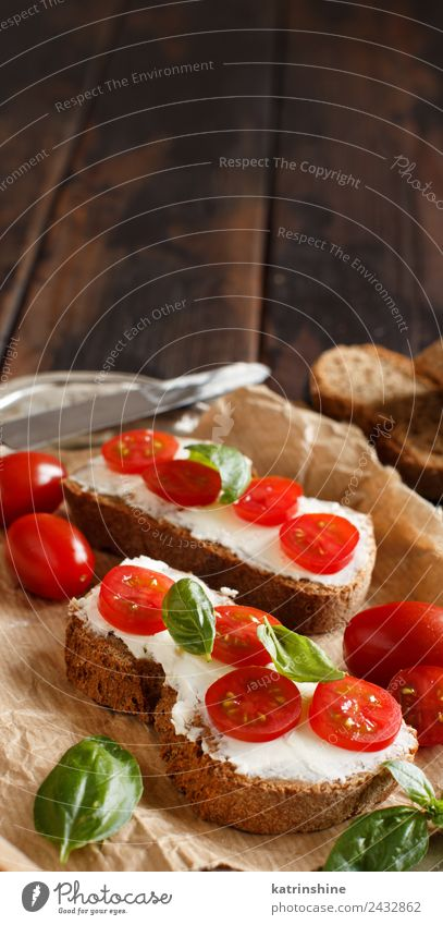 Bruschetta with cream cheese, cherry tomatoes and basil Cheese Bread Eating Breakfast Lunch Fresh Green Red appetizer Baguette board bruschetta cooking Dairy