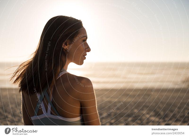 Woman enjoying beautiful sunset on the beach Lifestyle Happy Beautiful Harmonious Relaxation Meditation Vacation & Travel Freedom Summer Sun Beach Ocean Yoga