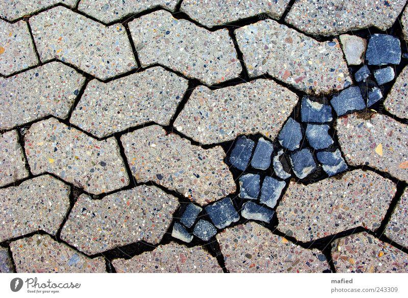 wound healing Paving stone Cobbled pathway Construction site Street Lanes & trails Stone Concrete Blue Gray Black Arrangement Symmetry Perfect Breakage Gap