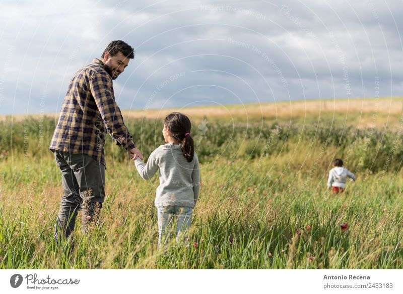 Fathers day Playing Child Baby Toddler Girl Boy (child) Man Adults Parents Brothers and sisters Family & Relations Infancy Flower Meadow Embrace