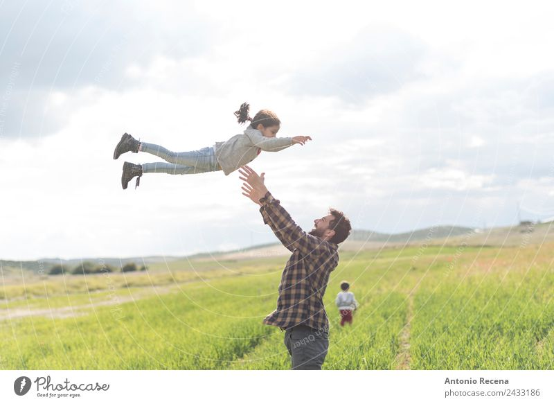 Father jump Child Human being Youth (Young adults) Man Flower 18 - 30 years Adults Meadow Family & Relations Playing Flying Infancy Toddler Parents Embrace