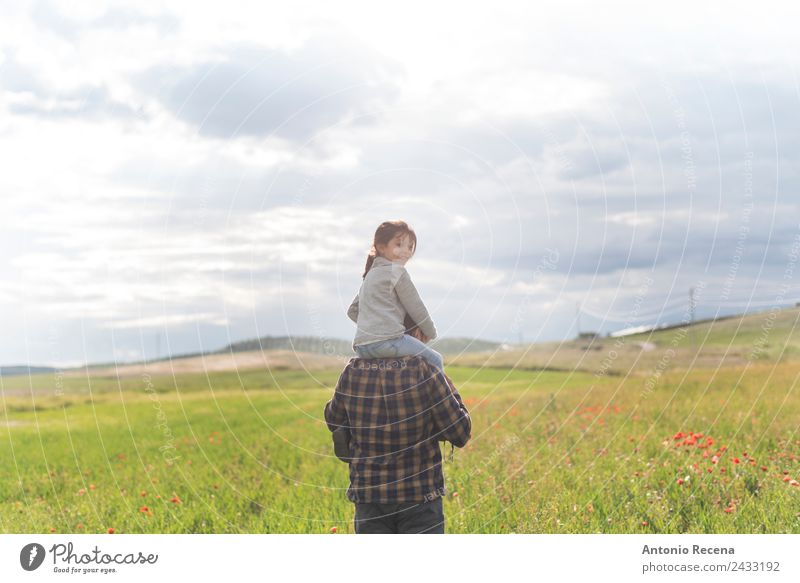 Father and daughter Playing Child Human being Girl Man Adults Parents Family & Relations Infancy 2 3 - 8 years 30 - 45 years Flower Meadow Smiling Embrace