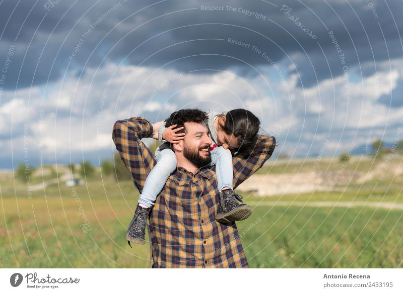 Father and daughter playing outdoors in cloudy day Playing Child Girl Man Adults Parents Family & Relations Infancy 2 Human being 3 - 8 years 18 - 30 years