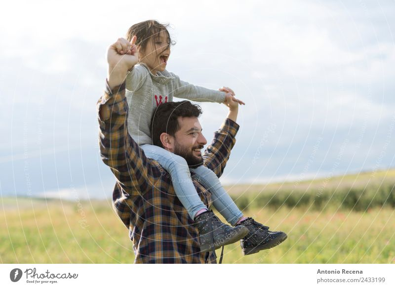 Father and daughter Playing Child Girl Man Adults Parents Family & Relations Infancy 2 Human being 3 - 8 years 18 - 30 years Youth (Young adults) Flower Meadow