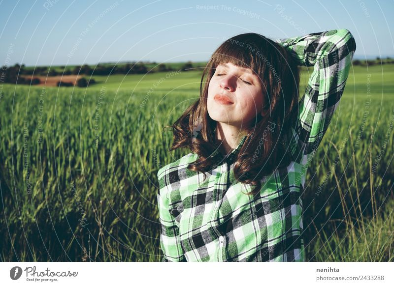Young happy woman enjoying a sunny day in nature Lifestyle Style Joy Healthy Wellness Harmonious Senses Relaxation Vacation & Travel Freedom Summer Sun