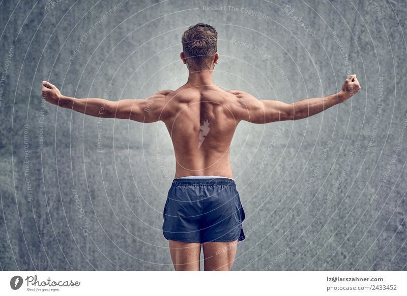 Young male bodybuilder posing Body Sports Man Adults 18 - 30 years Youth (Young adults) Fitness Muscular Strong Power back Posture background fit Musculature