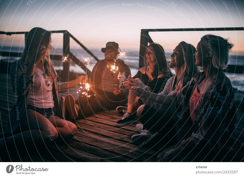 friends enjoying the sunset with sparkles on a pier Joy Happy Beautiful Freedom Summer Sun Ocean Man Adults Friendship Group Nature Sky Coast Smiling Love Sit